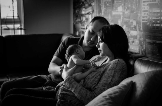 newborn baby with parents at home